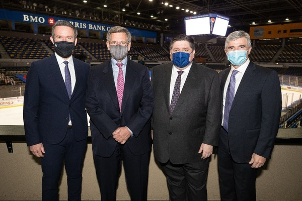"""(right to left) ASM Global's Doug Thornton standing with Illinois Governor J.B. Pritzker, Blackhawks Chairman W. Rockwell """"Rocky"""" Wirtz and CEO Danny Wirtz at the BMO Harris Bank Center in Rockford, IL on April 6, 2021"""