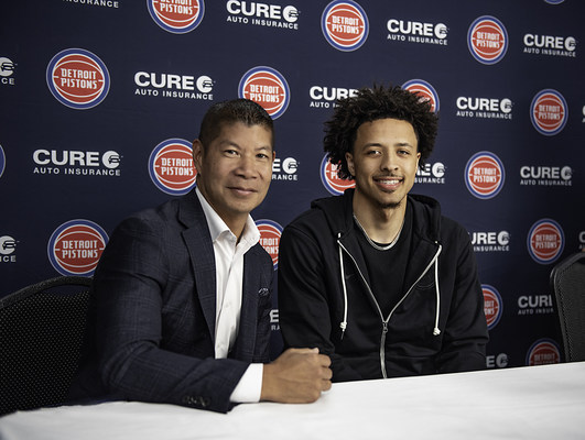 Eric S. Poe, CEO, CURE auto insurance and Cade Cunningham, Detroit Pistons 2021 #1 overall draft pick